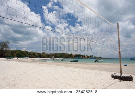 A Beach Volleyball Net On The Beach.