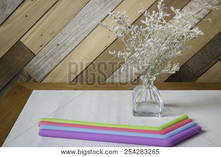 Silicone Drinking Straw On Table, Stock Photo