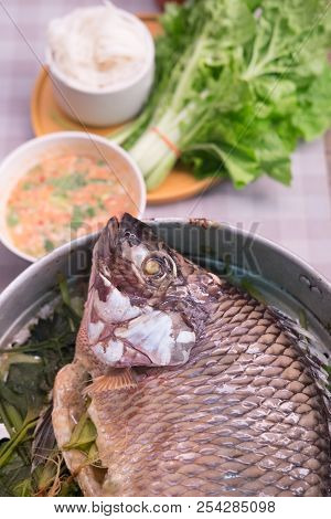 Mango Fish Steamed With Herbs In Pot Cooking In Steaming Pot