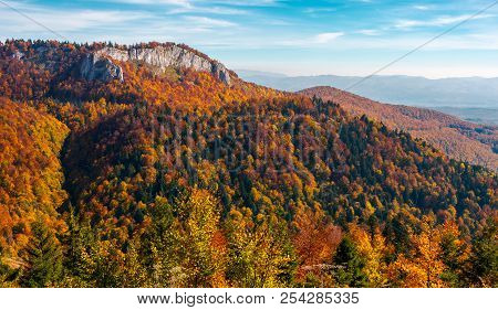 Gorgeous Mountainous Autumn Landscape. Cliff Above The Forest With Colorful Foliage. Beautiful View