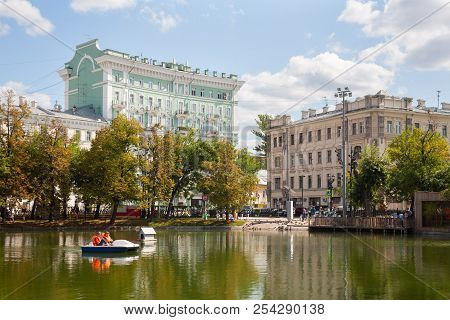 Moscow, Russia - August 17, 2018: Pond, Catamaran, Trees And Buildings In Chistoprudny Boulevard. Th
