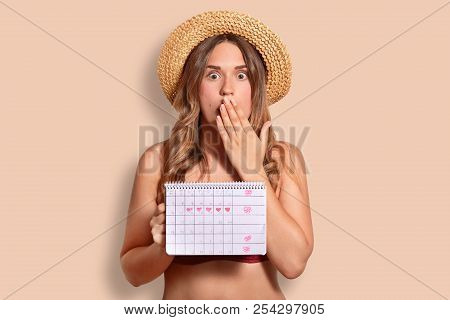 Shocked Terrified Female Covers Mouth With Palm, Shcoked To Have Periods, Holds Period Calendar, Wea