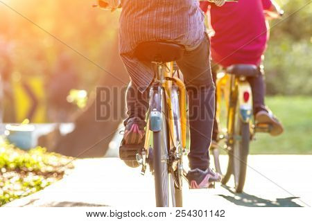 Family Active Biking In The Park At Sunset Background