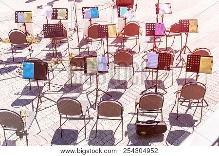 Russia, Samara, May 27, 2018: Empty Chairs And Notes On The Music Stand. Empty Seats In The Orchestr