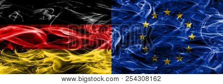 Germany Vs European Union Smoke Flags Placed Side By Side. German And European Union Flag Together