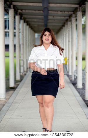 Asian Pretty Smiley Face Fat Woman Pose In Student Uniform On Walkway. 1