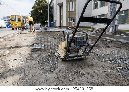 Vibrational Paving Stone Machine For Finish On A Sidewalk Road Construction Site Staying On A Ground