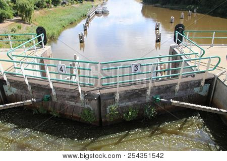 Sluice In The Lemstervaart Canal To Inner Lake Ijsselmeer In Lemmer. Difference Between Waterheights