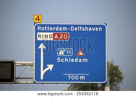 Direction And Speed Sign Above Motorway A20 With Warning For Dangerous Curve Junction To Schiedam