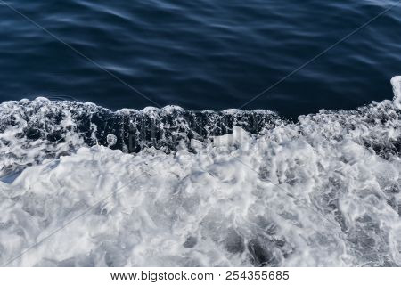 Flying Sea Water In The Sea. White Foam Of Sea Water. Dark Deepness In The Sea.