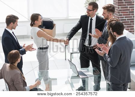 boss and the new employee shaking hands with each other