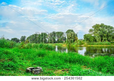 Summer Landscape - River, Surrounded By Trees, A Place For A Campfire. River, Trees And A Summer Daw