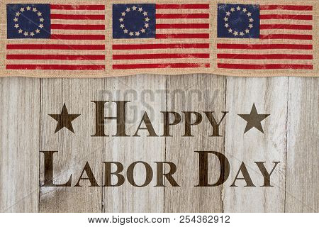 Happy Labor Day Greeting, Usa Patriotic Old Flag On A Weathered Wood Background With Text Happy Labo