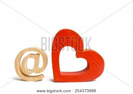 An E-mail Icon On A White Background And A Red Heart. Love Correspondence, Communication On The Inte