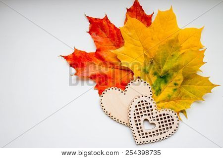 Still Life Of Wooden Hearts And Colorful Leaves.autumn Still Life, Copy Space, Dark Background, Autu