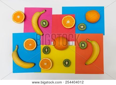 Food Pattern Made Of Oranges, Kiwi Fruits And Bananas On Colorful Background