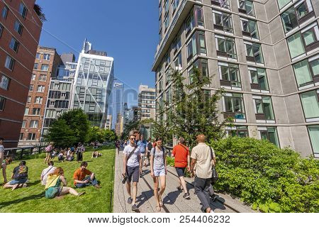 New York, Usa - May 25, 2018: People Walking Along The High Line In New York. It Is A Elevated Green