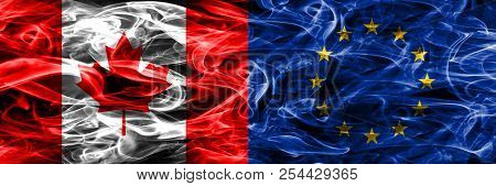 Canada Vs European Union Smoke Flags Placed Side By Side. Canadian And European Union Flag Together