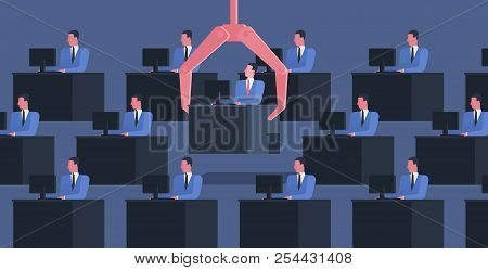 Identical People Sit At Desks With Computers And Large Robotic Arm Grabbing One Of Them. Concept Of