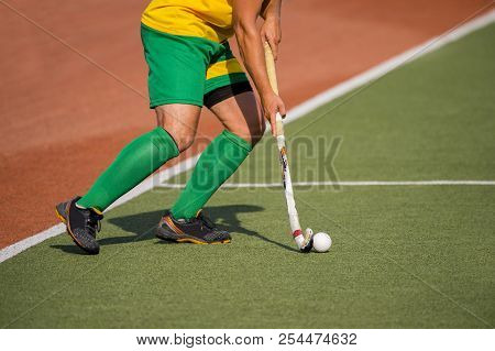 Field Hockey Player, In Possesion Of The Ball, Running Over An Astroturf Pitch, Looking For A Team M