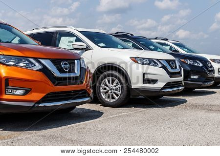 Fishers - Circa August 2018: New Vehicles At A Nissan Car And Suv Dealership. Nissan Is Part Of The