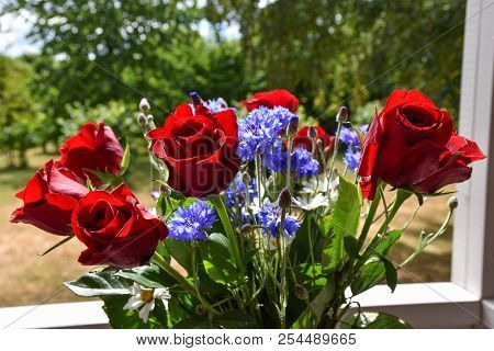 Flower Bouquet With Beautiful Red Roses And Cornflowers