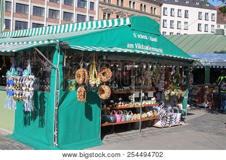 Munich, Germany - 10/15/2016: Vendors Display Selling Wares And Souvenirs  At Victuals Market In Mun
