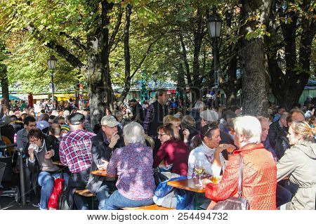 Munich, Germany - 10/15/2016: People Enjoying Drinks And Food  At Victuals Market In Munich Germans