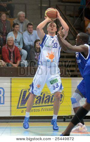KAPOSVAR, HUNGARY - OCTOBER 15: Nik Raivio (33) in action at a Hugarian National Championship basketball game Kaposvar (white) vs. Jaszbereny (blue) on October 15, 2011 in Kaposvar, Hungary.