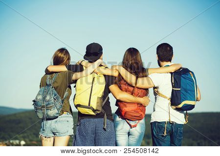 People, Women Or Girls And Handsome Men Watching Idyllic Landscape On Mountain Top. Friends Or Touri