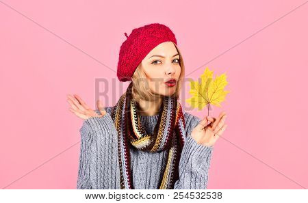 Autumn. Sexy Woman In Red Hat Holds Maple Leaf. Woman With Autumn Leaf. Yellow Maple Leaf. Woman Hol