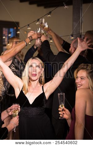 Beautiful Mature Woman Dancing At A Party Or Reception