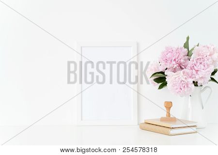 White Blank Frame Mockup. Still Life Composition, Floral Bouquet Of Pink Peonies In Jug, Stamp. Whit