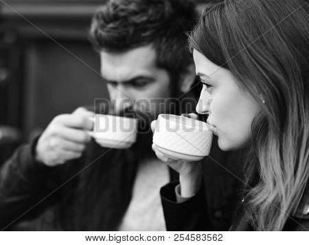 Couple In Love Drinks Espresso During Coffee Break. Dating At Urban Cafeteria Concept. Woman And Man