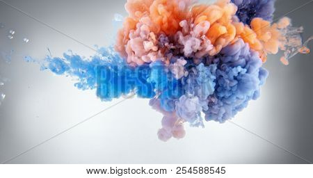 Acrylic colors and ink splash in water background