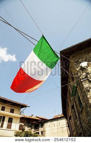 Italian Flag Pending In Blue Sky