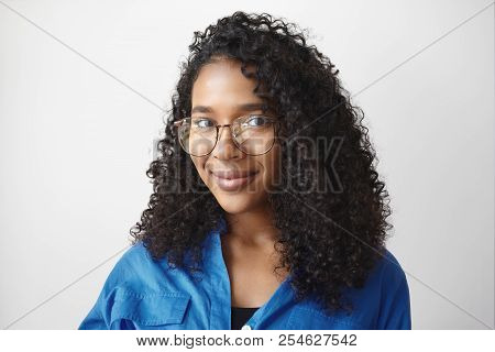 Isolated Shot Of Beautiful Young Black Haired African American Woman Wearing Blue Shirt And Fashiona