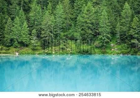 Forest And Turquoise Lake In The Dolomites Apls, Italy. Sorapis Lake In The Italy. Beautiful Landsca
