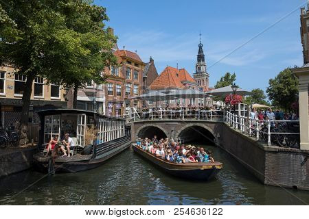 Alkmaar, Netherlands - July 20, 2018: Touristic sight seeing boat trip in the historical center of Alkmaar
