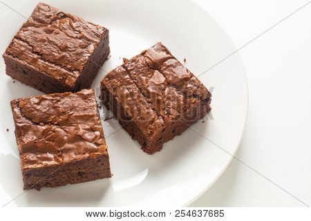 Homemade Organic Fudge And Crispy Brownies On White Plate