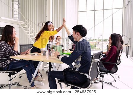 Group Of Young Multiethnic Diverse People Gesture Hand High Five, Laughing And Smiling Together In B
