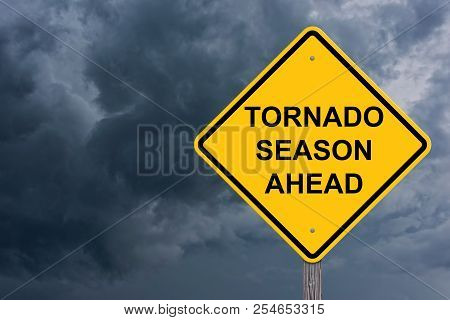 Tornado Season Ahead Caution Sign With Storm Cloud Background
