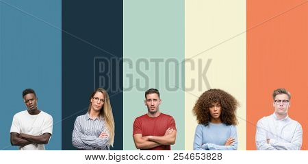 Group of people over vintage colors background skeptic and nervous, disapproving expression on face with crossed arms. Negative person. poster