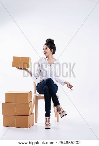 The Lady In White Shirt ,blue Jean And Pink Pastel High Heels,posing By Sitting On Wooden Chair,rais