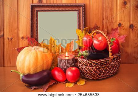 Fresh Vegetables, Candle And Picture Frame With Autumn Maple Leaves