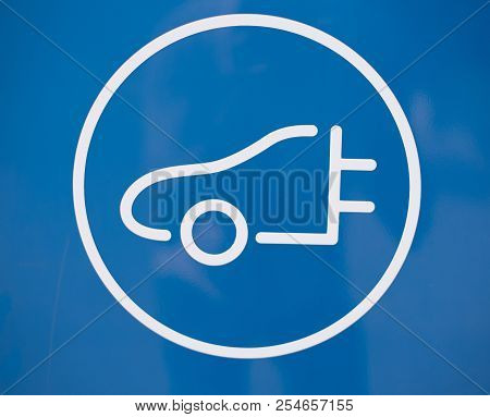 Symbol For Charging Station In Blue With Circle