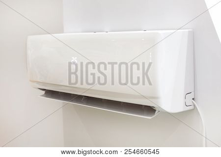 White Air Conditioner On A Wall With Temperature Display. Closeup Image.