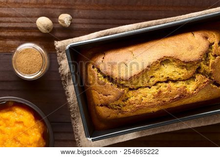 Fresh Homemade Pumpkin Bread In Pan, Ingredients (pumpkin Puree, Cinnamon, Nutmeg) On The Side, Phot