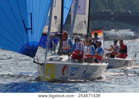 ST. PETERSBURG, RUSSIA - AUGUST 3, 2018: Teams from Switzerland and Germany compete in Semifinal 2 of Sailing Champions League. 25 sailing teams participate in the competitions