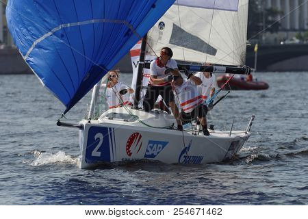 ST. PETERSBURG, RUSSIA - AUGUST 3, 2018: Team SCTWV Achensee from Austria compete in Semifinal 2 of Sailing Champions League. 25 sailing teams participate in the competitions